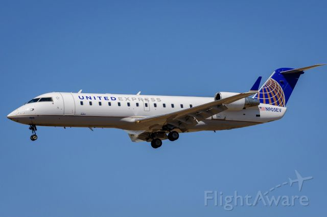 Canadair Regional Jet CRJ-200 (N905EV) - Arrival KLAX photographed from Proud Bird patio.