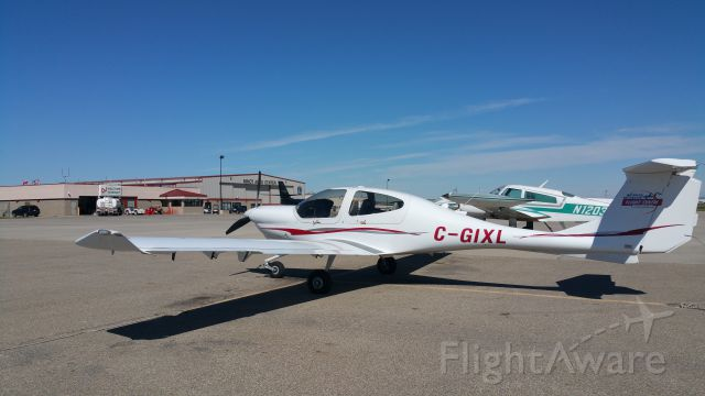 Diamond Star (C-GIXL) - Sitting on the ramp at the Minot Aero Center in Minot, North Dakota.