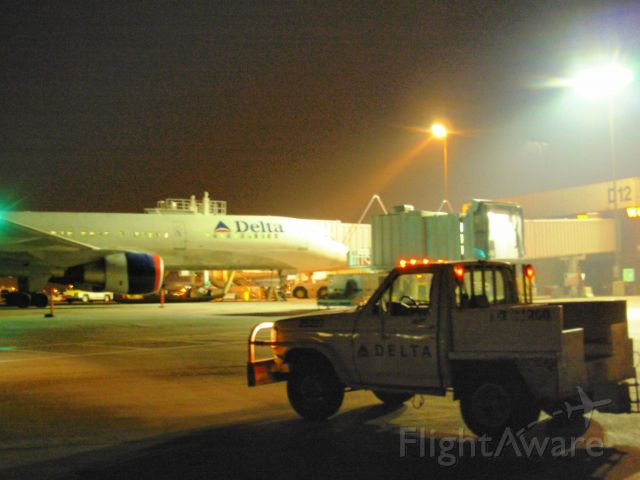 "Boeing 757-200 — - My cargo ""bobtail"" truck near D12, a B752 at D13."