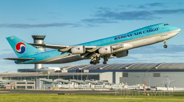 BOEING 747-8 (HL7617) - This Korean Cargo 748 heading to Anchorage past a very underused Terminal One at YYZ