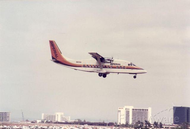 Beechcraft Sundowner (N691A) - Imperial Shorts 360 landing at Santa Ana in the mid-1980s