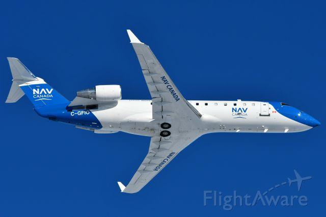 Canadair Regional Jet CRJ-200 (C-GFIO) - Nav Canada Bombardier CRJ-200ER doing instrument calibration at YYC on Nov 25.