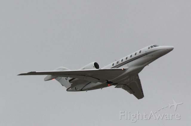 Cessna Citation X (N779XJ) - N779XJ departs Runway 14 at Sarasota-Bradenton International Airport enroute to New Castle Airport