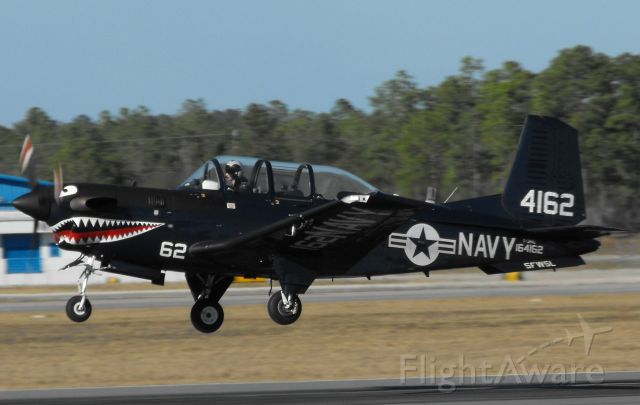 """Beechcraft Mentor (16-4162) - """"Devil 3"""" departing RWY 27 in Tallahassee. Thought the USN retired the T-34Cs?"""