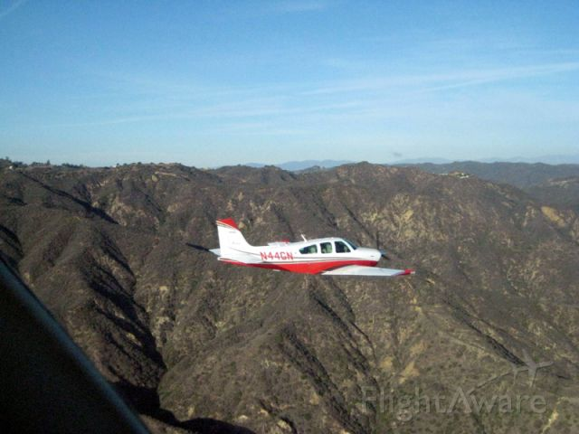 Beechcraft Bonanza (33) (N44GN) - Over Malibu Beach in California.  Photo by Bob Nicholas aboard N112TW.