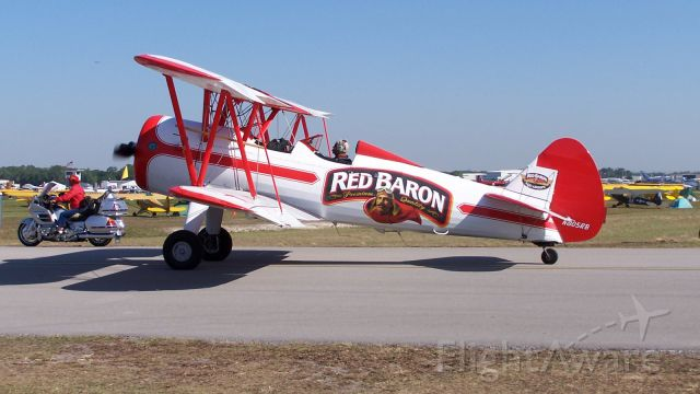 Boeing PT-17 Kaydet (N805RB) - A PT-17 of the Red Baron display team is escorted to the flight line at Lakeland, Florida.