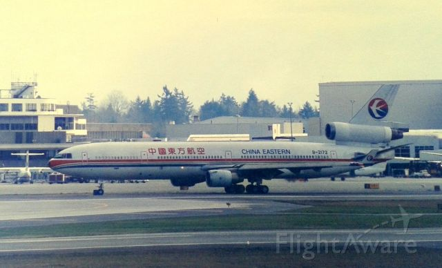 Boeing MD-11 (B-2172) - KSEA - China Eastern pax MD-11 rolling to the 16LR departure runways in Feb 1995. Photo from the SEA airpark( now closed )