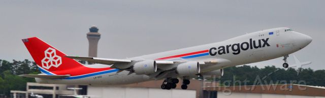 BOEING 747-8 (LX-VCD) - Notice the vortices coming off the engines