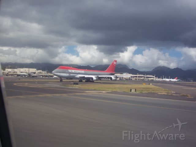 Boeing 747-200 — - Northwest 747-200 taxiing out at PHNL. Taken from Aloha 737-200 taxiing in.