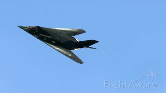 Lockheed Nighthawk — - Lockheed F-117 Nighthawk low altitude fly-by with vapor forming over the wings. Naval Air Station Whidbey Island, Washington.