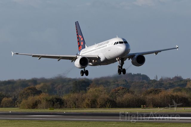 Airbus A319 (OO-SSI) - BEL2173 just before landing at Manchester 05R
