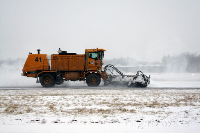 — — - Removing snow during todays snow storm