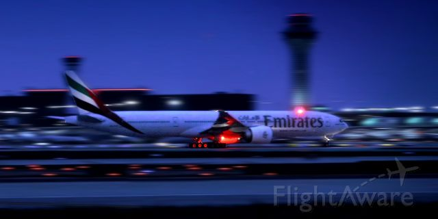 BOEING 777-300ER (A6-ECF) - UAE/EK236 took off on runway 10L on 07/12/2015. Since I used very high iso to capture such fast moment, the picture is not of high quality. But the color and motion are amazing.