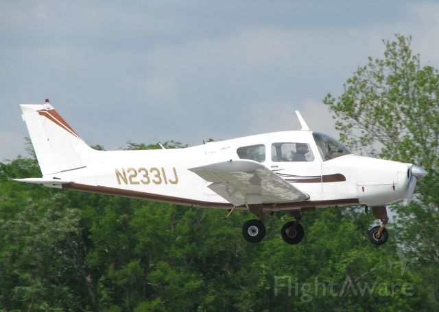 Beechcraft Sundowner (N2331J) - Landing on 14 at Downtown Shreveport.