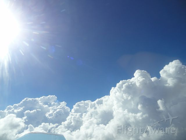 Beechcraft 35 Bonanza (N1866D) - Breathtaking clouds... (8/4/2014)