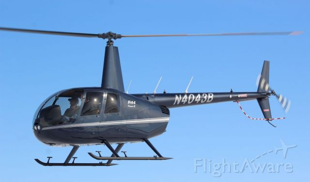 Robinson R-44 (N4043B) - Whiteside Co. Airport 16 Feb 2021<br />This smart looking R44 Raven II popped in for a little bit.<br />Gary C. Orlando Photo