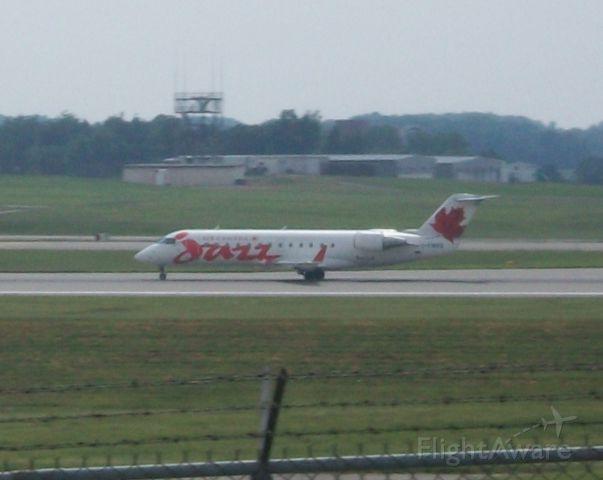 Canadair Regional Jet CRJ-200 (C-FWRS) - Jazz 7984 Departs 18L back to Toronto in this Red RJ.    Taken: 6/27/2010