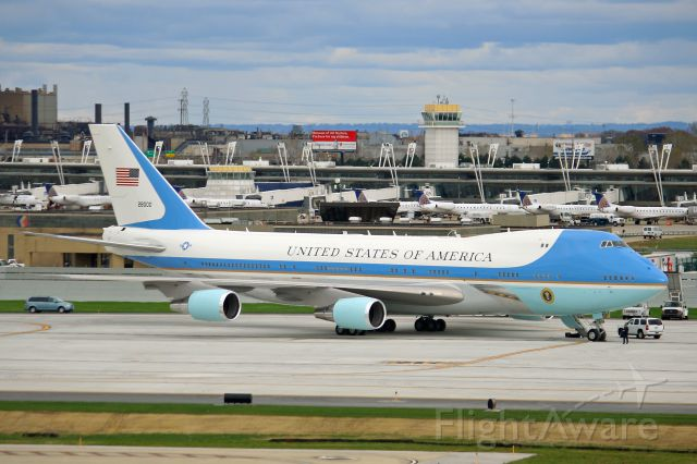 Boeing 747-200 (82-8000) - Air Force One, USAF VC-25A, B747-2G4B, tail number 82-8000, c/n 23824, parked on Pad-3 with D-concourse in the background as seen looking east from the old airport surveillance radar tower on 31 Oct 2010. Special clearance was obtained from the USSS for me to go up there to get the photo. The D-Concourse now sits abandon after United abandon the City of Cleveland and took their hub out.