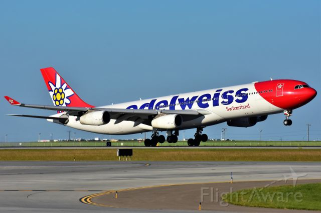 Airbus A340-300 (HB-JME) - Edelweiss Air Airbus A340-313 arriving at YYC on July 21.