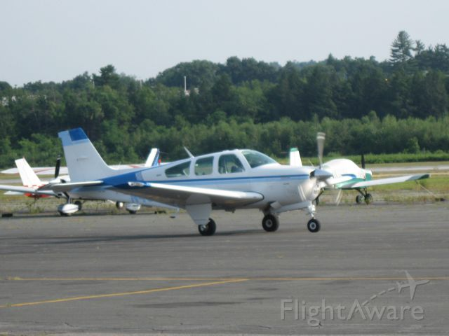 Beechcraft Bonanza (33) (N4505S) - Taxiing to runway 20 for a departure to Bedford, MA. (KBED).