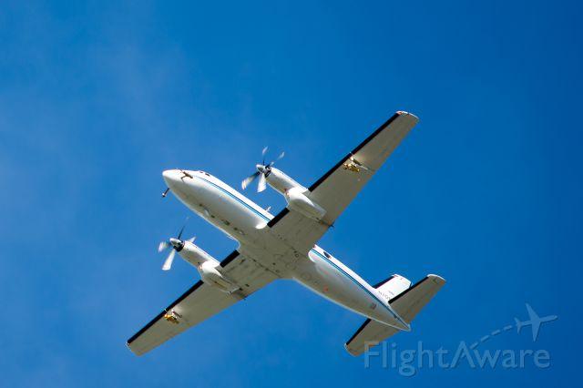 Grumman Gulfstream 1 (N701BN) - 1500 feet overhead RIU