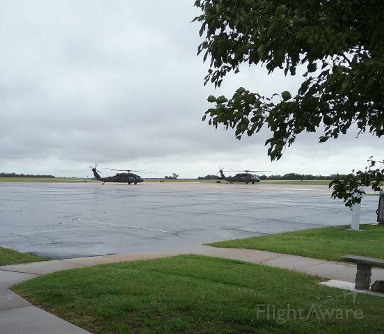 — — - Two Blackhawks departing.