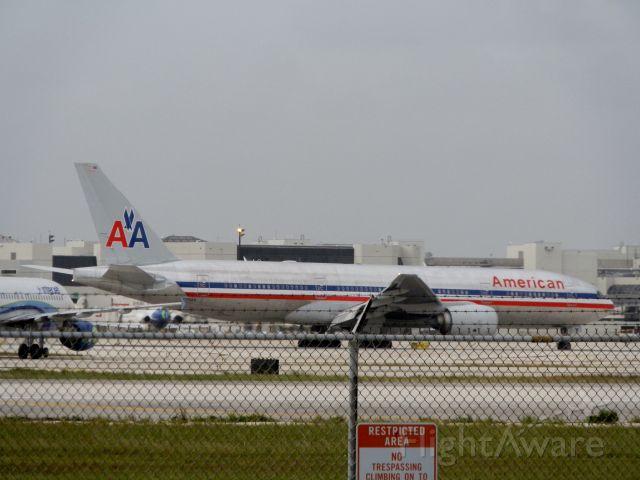 Boeing 777-200 (N799AN) - An Interjet A320.Back left