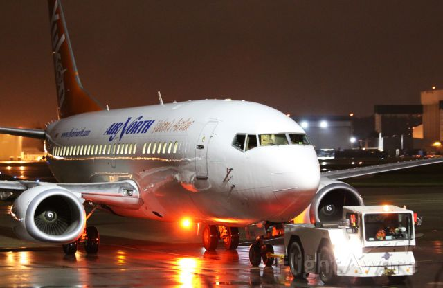 Boeing 737-500 (C-GANJ) - Air North 737 being towed to the parking stand for overnight at YVR