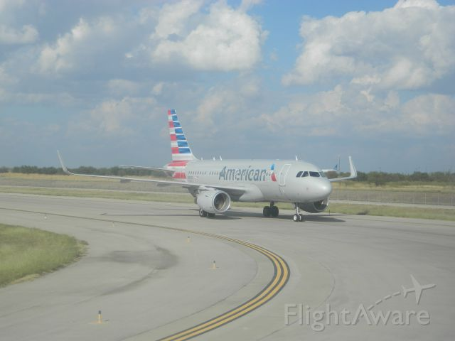 Airbus A319 (N9006) - An American Airlines A319, only a year old, taxiis off the runway on a hot October day at DFW.