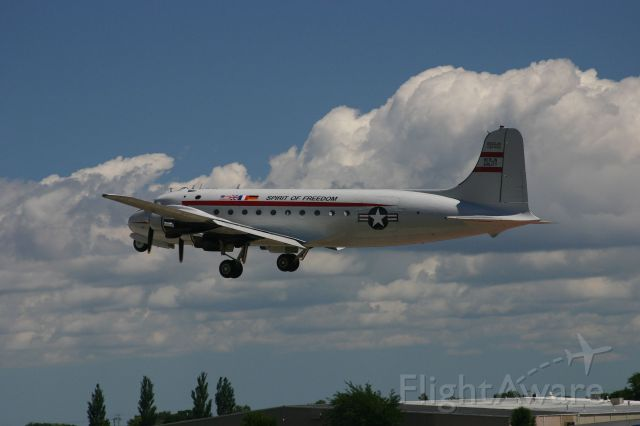 Douglas C-54 Skymaster (N500EJ) - C54 on take off at the EAA Fly In 7-29-2005