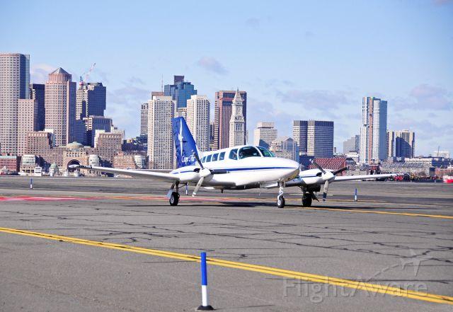 Cessna 402 — - RWY32 landing - Boston Skyline scenery