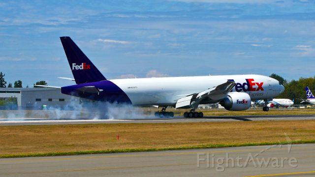 Boeing 777-200 (N893FD) - BOE241 makes tire smoke on landing Rwy 34L on 8.13.19. (B777-FS2 / ln 1616 / cn 41736).