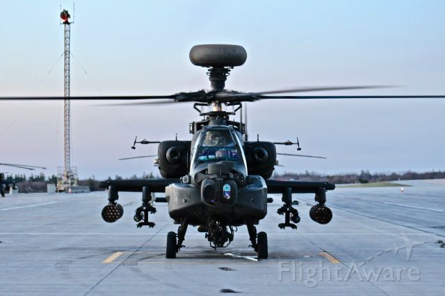 — — - An AH-64D Apache Longbow readies for departure to conduct a training sortie.