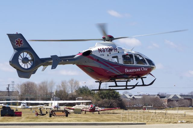 Eurocopter EC-635 (N312PH) - Taking off from mobile helipad at KVLL.