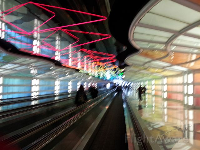 — — - Tunnel between C and D concourses at O'Hare International