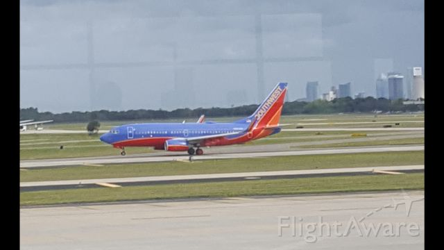 Boeing 737-700 — - Just one of the few pictures I took while waiting for our united a320 to arrive at Tampa.