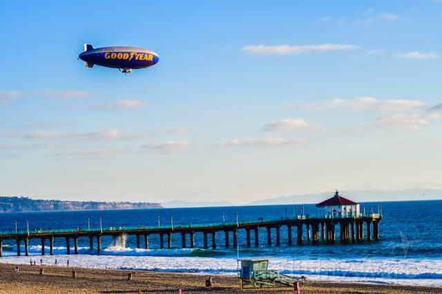 Unknown/Generic Airship (N4A) - Low Fly over at Manhattan Beach Pier.<br><br>This is part of the route for this ship. This day was beautiful - crystal clear... you can see Catalina in the background... and the world class surfers threading the pier.  As an FYI this was one of the last trips that this ship N4A took over the pier - it was retired, about four months after this pic was taken.