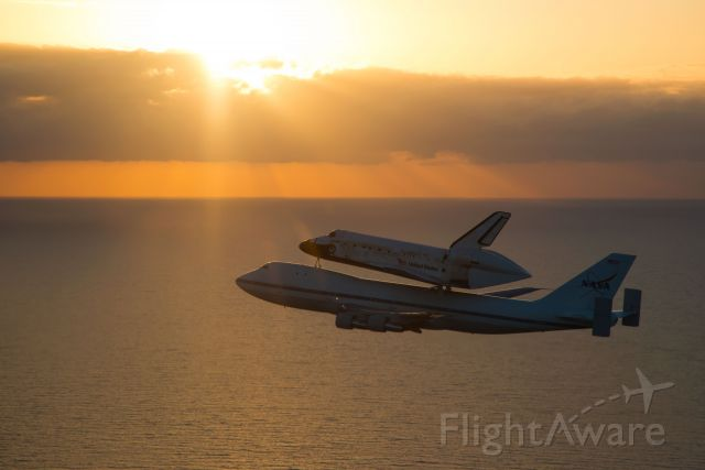 Boeing 747-200 (NASA905) - NASA 905 and Discovery shortly after takeoff from the Shuttle Landing Facility, Kennedy Space Center.
