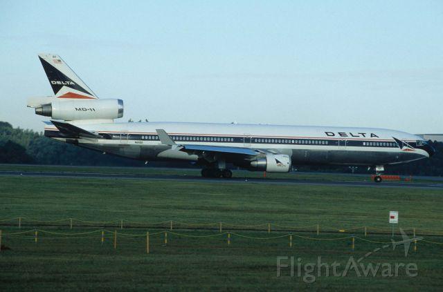 Boeing MD-11 (N811DE) - Departure at Narita Intl Airport Rwy16R on 1996/09/23