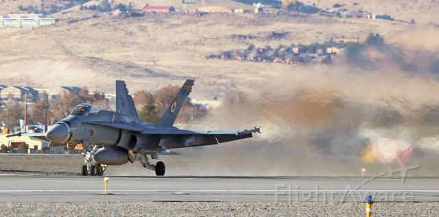 """McDonnell Douglas FA-18 Hornet (16-5220) - The first of four VMFA 323 """"Death Rattlers"""" F/A-18C Hornets (165220), call sign """"Snake One One,"""" has both candles lit as it comes blazing along KRNO's 16L to launch away at the start of a trip home to MCAS Miramar."""