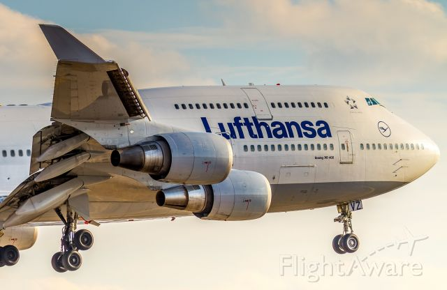 Boeing 747-400 (D-ABVZ) - February sunset shining directly down runway 23 on the nose of this Lufty 744