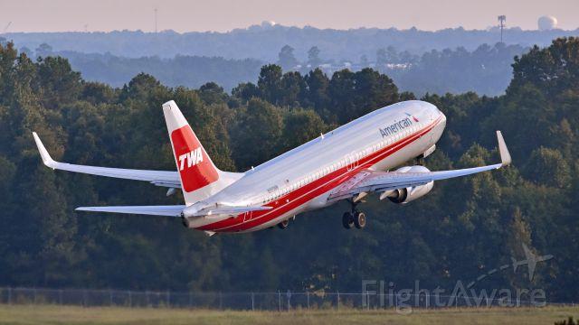 """Boeing 737-800 (N915NN) - American Airlines Boeing 737-800 (N915NN) """"TWA Heritage"""" departs KRDU Rwy 23L on 8/26/2018 at 6:24 pm."""