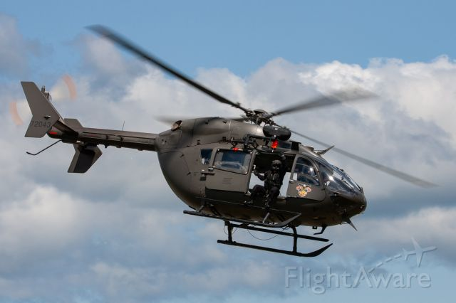 0872043 — - US Army Eurocopter UH-72 Lakota passes the crowd during the 2019 New York Airshow. The West Point Parachute Team used this helo as a jump platform.