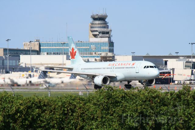 Airbus A320 (C-FFWN) - Leaving Montreal-Trudeau on runway 06R