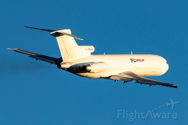BOEING 727-200 (N216WE) - So happy with this shot! During peak season at SDF, I noticed this 727 departed everyday around 4pm. I waited for a sunny day, and amongst the hundreds of UPS departures, got this 727 banking off of runway 17R in some stunning lighting!