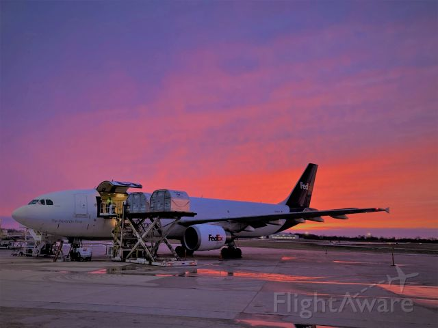 Airbus A300F4-600 (N670FE) - A rose colored sky shimmers off Flight 325's fuselage on 3-17-21. Flight 325 has just arrived from Fargo, ND and will have empty containers off loaded and full containers loaded in less than 45 minutes. Then ready for a punctual departure to Madison, WI