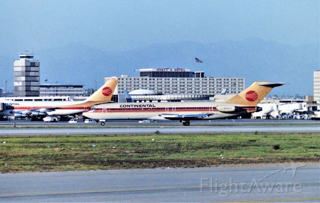 BOEING 727-200 (N574PE) - KLAX - from the Imperial Terminal parking lot circa Sept 1989 Continental 727 arriving 25L and rolling onto the exit chute to cross 25R when cleared. This is a lower angle sun shot late PM - one of the greater airliner photography spots back in the day - I was in LA for the Fall airline collectible show that year.