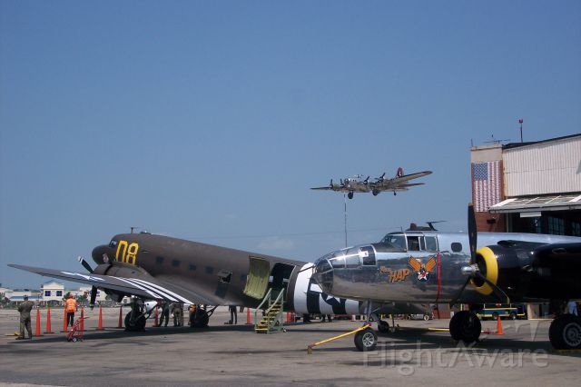 — — - A trio of warbirds, C-47, B-25 and a B-17 on short final at FRG.