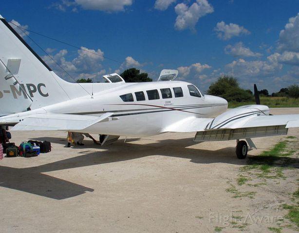Cessna 402 (ZS-MPC) - At a bush strip in the Okavango. Botswana.