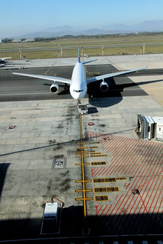 Airbus A330-300 (ZS-XSS) - You get an idea of the number of aircraft types that use this gate at Capetown by the tarmac markings